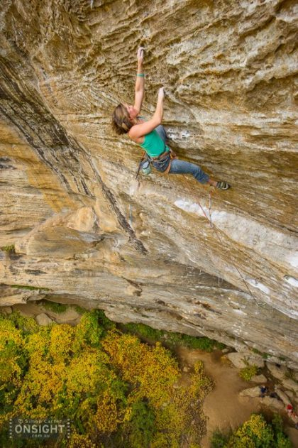Whitney Boland on Pushing Up Daisies (5.13d), Madness Cave. Photo: Simon Carter.