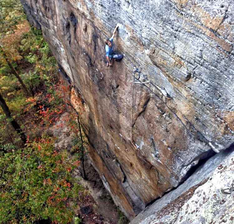 Mike Williams at the midway rest during the first ascent of Color Blind, probably wondering why there are no bolts anywhere.  Photo credit: Blake Cash