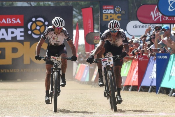 Christoph Sauser and Jaroslav Kulhavý sprint across the finish line to limit their time losses to Manuel Fumic & Henrique Avancini. Photo by Shaun Roy/Cape Epic/SPORTZPICS