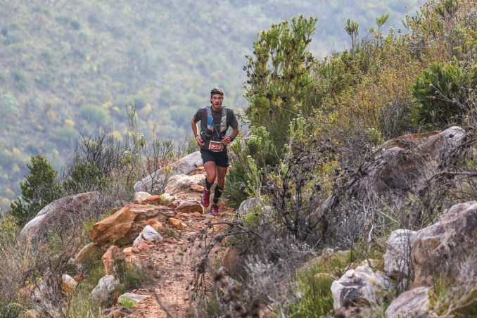 First Ascent's Stefan Wahl taking on the challenging route up the Swartberg Mountain; though the hiking trail is steep and challenging the views are breath-taking, making it the perfect mountain running stage. Photo by Oakpics.com.