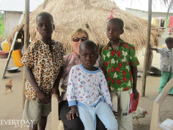 We sponsor Modeste (sitting in my lap) and his older brother, Yao (camera left)
