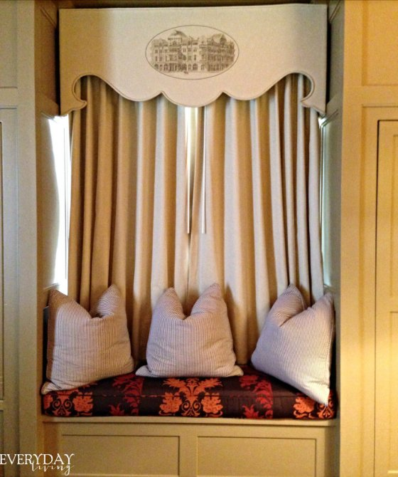 Window seat in our suite with The Driskill printed on the cornice