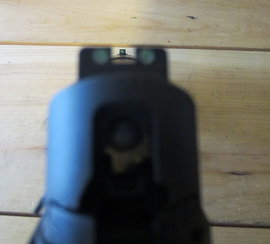 Green Truglo fiber optic front sight and Sig nigh sight rear sights