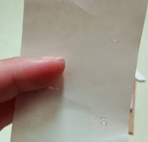 Glue dots on backing paper