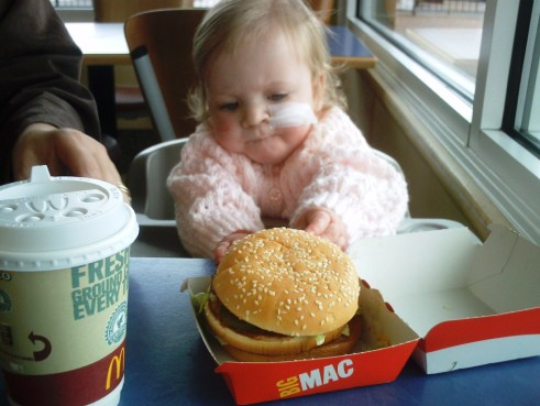 Small child eating at fast food restaurant
