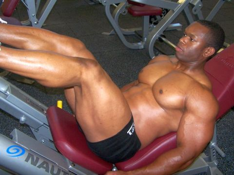 Man training legs on machine