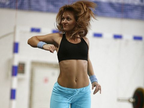 Woman jumping during workout.