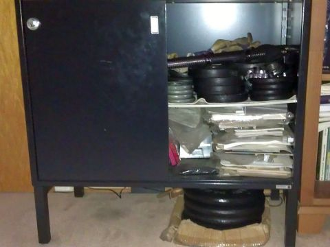 metal cabinet with weightlifting plates