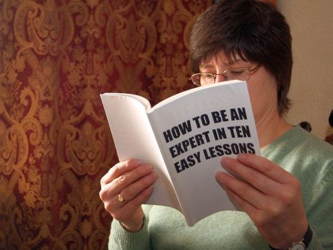 woman reading book on experts