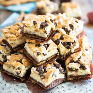 S'mores Cheesecake Bars, it's all the deliciousness of a classic Smores and the dreaminess of a creamy cheesecake rolled into one truly decadent treat!