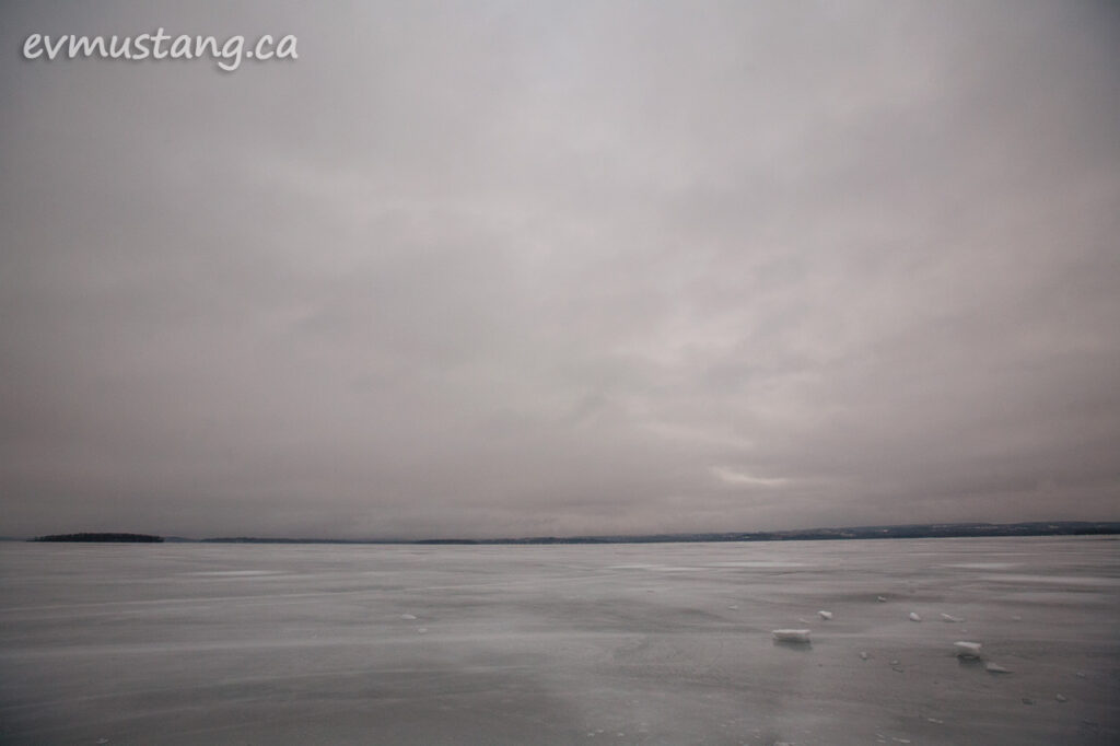 image of ice crust on rice lake under sun warmed cloud cover