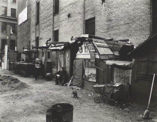 Huts and unemployed, West Houston and Mercer St., Manhattan