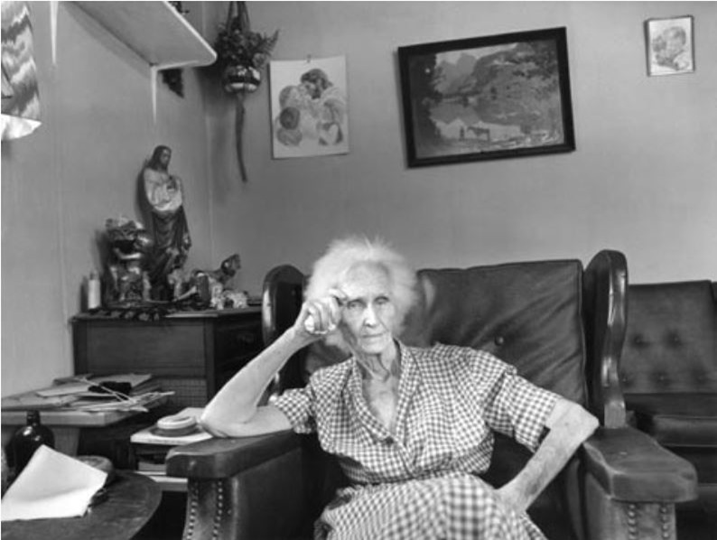 Nettie Featherston in the four-room house she shares with her son. Lubbock, Texas. August 1979.