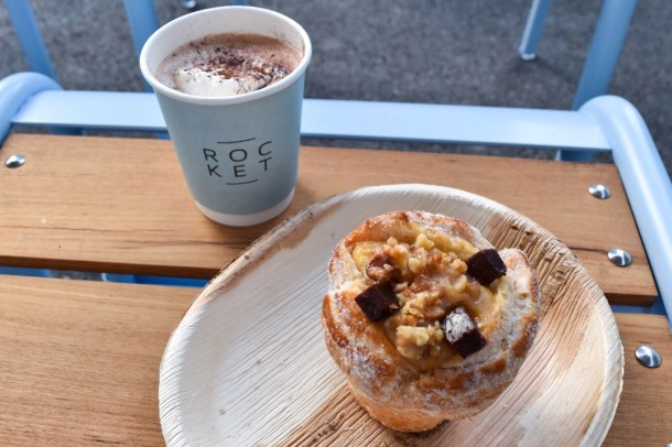 WE HAD A CRUFFIN! A CROISSANT MUFFIN HYBRID! And a drink that I ordered wrongly in my haste, and he was happy cause it was chocolate.