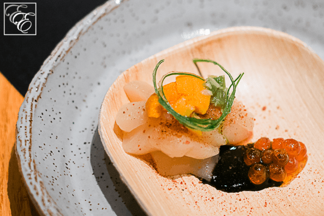 Hokkaido scallop with uni, ikura, fermented wasabi leaf, and nori ponzu