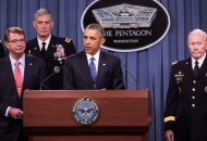 ARLINGTON, VA - JULY 6:  (AFP OUT) U.S. President Barack Obama delivers remarks after meeting with members of his national security team concerning ISIS at the Pentagon July 6, 2015 in Arlington, Virginia. From left, Secretary of Defense Ashton Carter, Commander of U.S. Africa Command Gen. David Rodriguez, and Chairman of the Joint Chiefs of Staff General Martin Dempsey. Obama announced the U.S. military is making progress against the Islamic State in Iraq and Syria. (Photo by Drew Angerer - Pool/Getty Images)