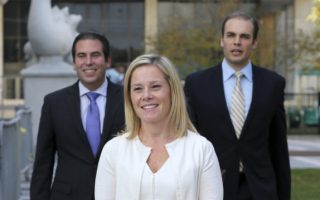 Gov. Chris Christie's former Deputy Chief of Staff Bridget Anne Kelly, center, leaves Martin Luther King Jr. Courthouse after a hearing, Wednesday, Oct. 19, 2016, in Newark, N.J. Three years after gridlock paralyzed a New Jersey town next to the George Washington Bridge for days, two former allies of New Jersey Gov. Chris Christie, Kelly and Bill Baroni, Christie's former top appointee at the Port Authority of New York and New Jersey, are being tried on charges of politically motivated lane closures of the George Washington Bridge in 2013. (AP Photo/Mel Evans)
