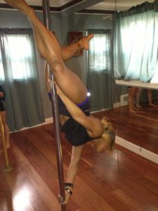Me upside down in a pole lesson