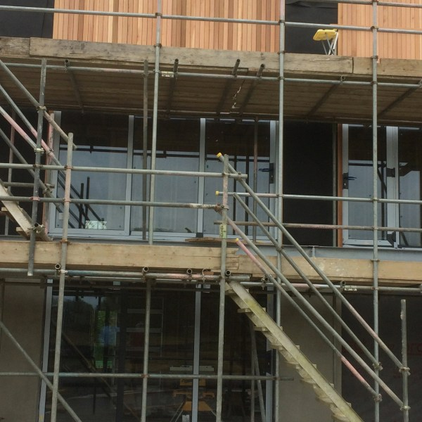 Cedar cladding to the upper level