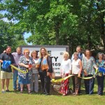 Chamber Holds Duel Ribbon Cutting