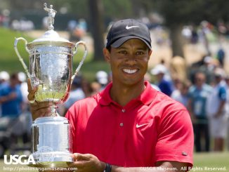 Tiger Woods with the trophy after winning the 2008 U.S. Open Championship at Torrey Pines Golf Course in San Diego, California on Monday, June 16, 2008.  (Copyright USGA/John Mummert)