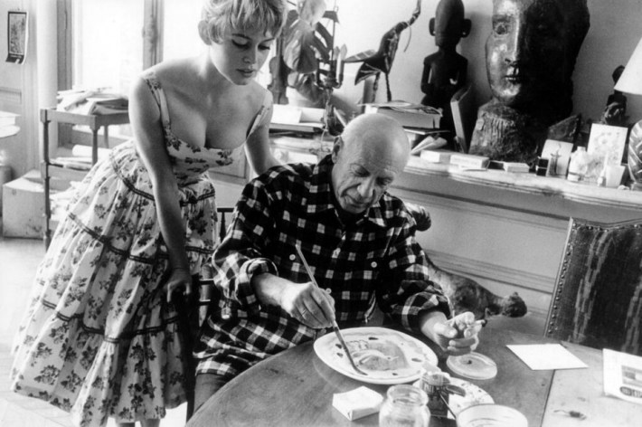 Brigitte Bardot visits Pablo Picasso at his studio near Cannes in 1956.