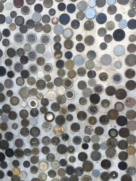 A wall of coins. Photo by Kat.