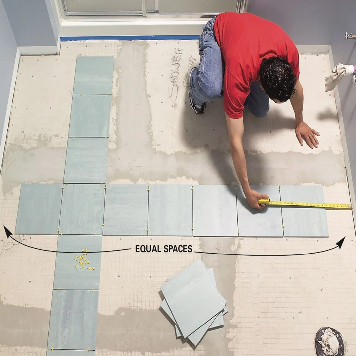 How To Lay Tile Install A Ceramic Tile Floor In The Bathroom Diy Family Handyman