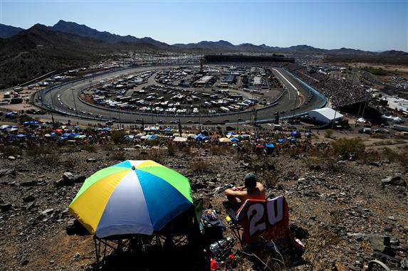 Race fans sit atop Rattlesnake Hill and watch the action during the NASCAR Sprint Cup Series SUBWAY Fresh Fit 500 at Phoenix International Raceway on March 4, 2012  Photo - Robert Laberge/Getty Images