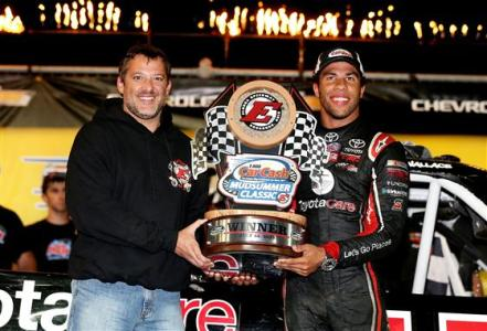 Tony Stewart presents Darrell Wallace Jr. , driver of the #54 ToyotaCare Toyota, with a trophy after winning the Camping World Truck 2nd Annual 1-800 Car Cash Mudsummer Classic at Eldora Speedway on July 23, 2014  Photo - Sean Gardner/Getty Images