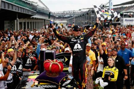 Jeff Gordon, driver of the #24 Axalta Chevrolet, celebrates in Victory Lane after winning the NASCAR Sprint Cup Series Crown Royal Presents The John Wayne Walding 400 at the Brickyard Indianapolis Motor Speedway on July 27, 2014 Photo - Chris Trotman/Getty Images