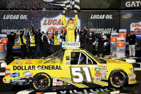 Kyle Busch, driver of the #51 Dollar General Toyota, celebrates in Victory Lane after winning during the NASCAR Camping World Truck Series Lucas Oil 225 at Chicagoland Speedway on September 13, 2014 Photo - Daniel Shirey/Getty Images