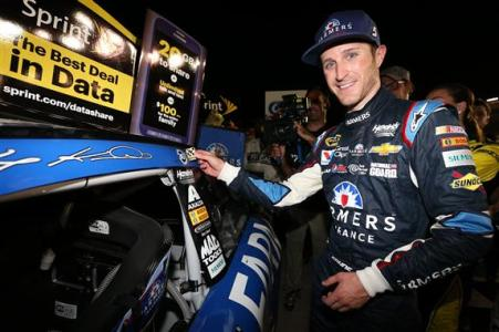 Kasey Kahne, driver of the #5 Farmers Insurance Chevrolet, applies the winner's decal in Victory Lane after winning the NASCAR Sprint Cup Series Oral-B USA 500 at Atlanta Motor Speedway on August 31, 2014 Photo - Nick Laham/Getty Images