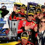 Brad Keselowski, driver of the #2 Redd's Wicked Apple Ale Ford, celebrates in victory lane after winning during the NASCAR Sprint Cup Series GEICO 500 at Talladega Superspeedway on October 19, 2014 Photo - Jonathan Ferrey/Getty Images