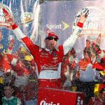 Kevin Harvick, driver of the #4 Budweiser Chevrolet, celebrates in victory lane after winning the NASCAR Sprint Cup Series Quicken Loans Race for Heroes 500 at Phoenix International Raceway on November 9, 2014 Photo - Tom Pennington/Getty Images