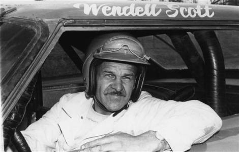 Wendell Scott poses for a portrait in his car. He was the first African-American driver to win in the NASCAR Cup division with a victory in 1963 at Jacksonville Speedway Park in Jacksonville, Florida. Scott was NASCAR's first black competitor, starting in the sportsman class in 1953. Photo - Getty Images Archive