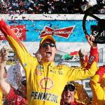 Joey Logano, driver of the #22 Shell Pennzoil Ford, celebrates in victory lane after winning the NASCAR Sprint Cup Series 57th Annual Daytona 500 at Daytona International Speedway on February 22, 2015 Photo - Chris Graytham/Getty Images