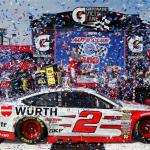 Brad Keselowski, driver of the #2 Wurth Ford, celebrates in Victory Lane after winning the NASCAR Sprint Cup Series Auto Club 400 at Auto Club Speedway on March 22, 2015 Photo - Jerry Markland/Getty Images