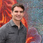 "Four-time NASCAR Sprint Cup Series champion Jeff Gordon poses for a photo in front of the Dallas Museum of Art during ""Jeff Gordon Day"" at Klyde Warren Park on March 12, 2015 in Dallas, Texas.  Photo - Sarah Glenn/Getty Image"