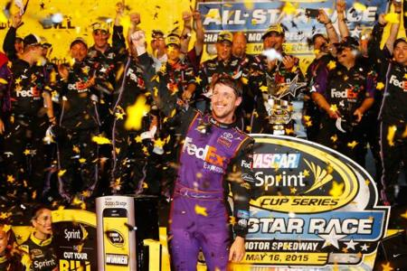 Denny Hamlin, driver of the #11 FedEx Express Toyota, celebrates in victory lane after winning the NASCAR Sprint Cup Series Sprint All-Star Race at Charlotte Motor Speedway on May 16, 2015 Photo - Jerry Markland/Getty Images