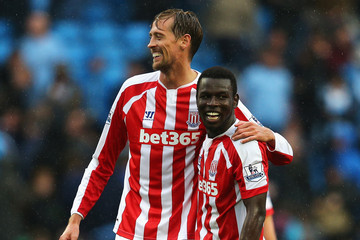 Crouch and Diouf  (StokeCityFC.com)