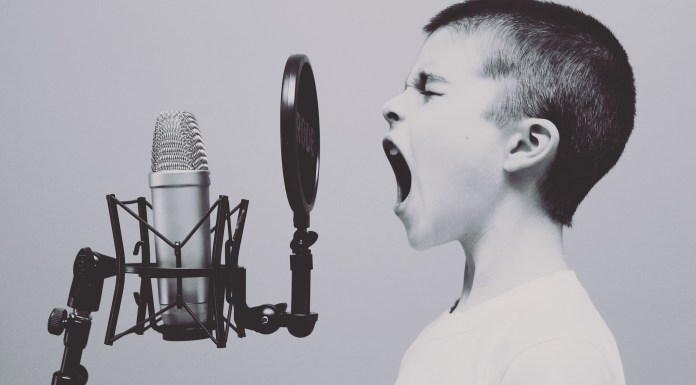 child yelling into a microphone