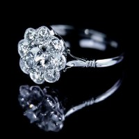 Jeweller in London: Diamond daisy engagement ring
