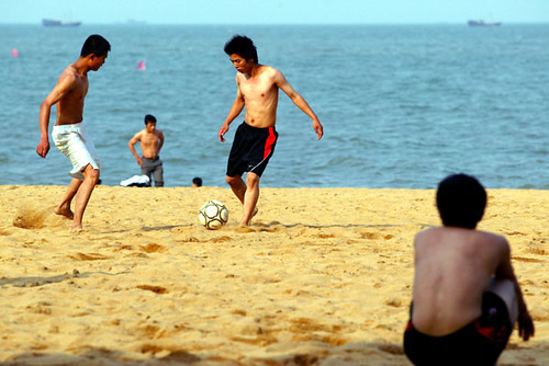 Chinese boys playing football