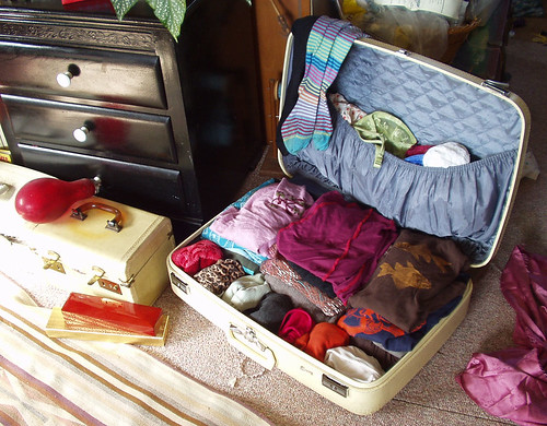 I store my clothes in suitcases