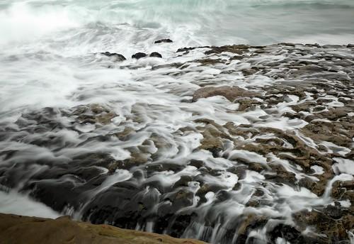 Wave returns on rocks, La Jolla Cove