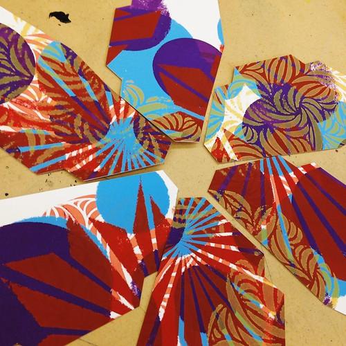 Screen prints cut into pieces