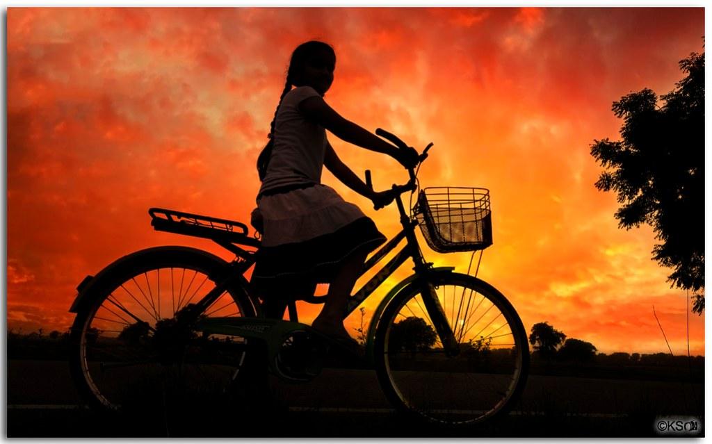 Girl at dusk riding homewards!