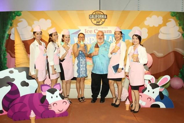 California Milk Advisory Board officials strikes a pose with CMAB's Mooexplorers