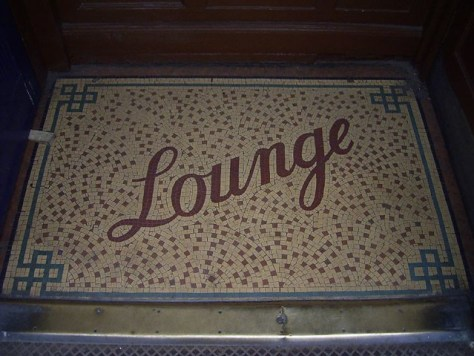 Floor mosaic advertising a pub lounge bar, by Duncan C, via Flickr.